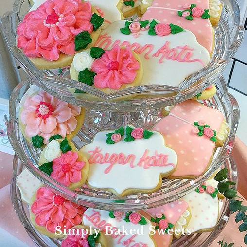Pretty pink floral cookies including buttercream flowers