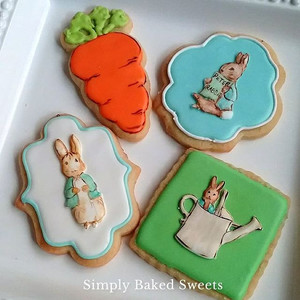 Handpainted royal icing transfers adorn these adorable cookies