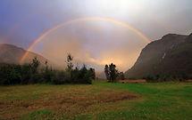 storyblocks-rainbow-after-rain-over-moun