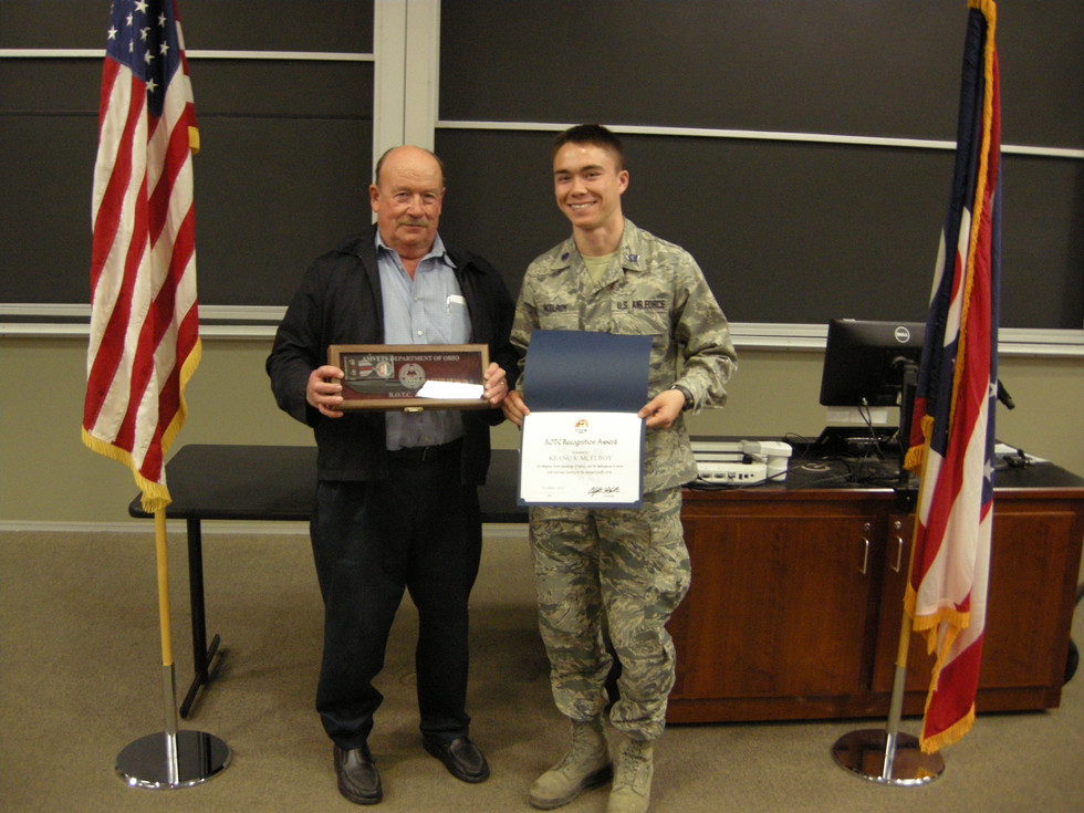 George Benz presents the AMVETS Department of Ohio award to Air Force ROTC cadet Keanu S. McElroy at Capital University on 24 April 2018.