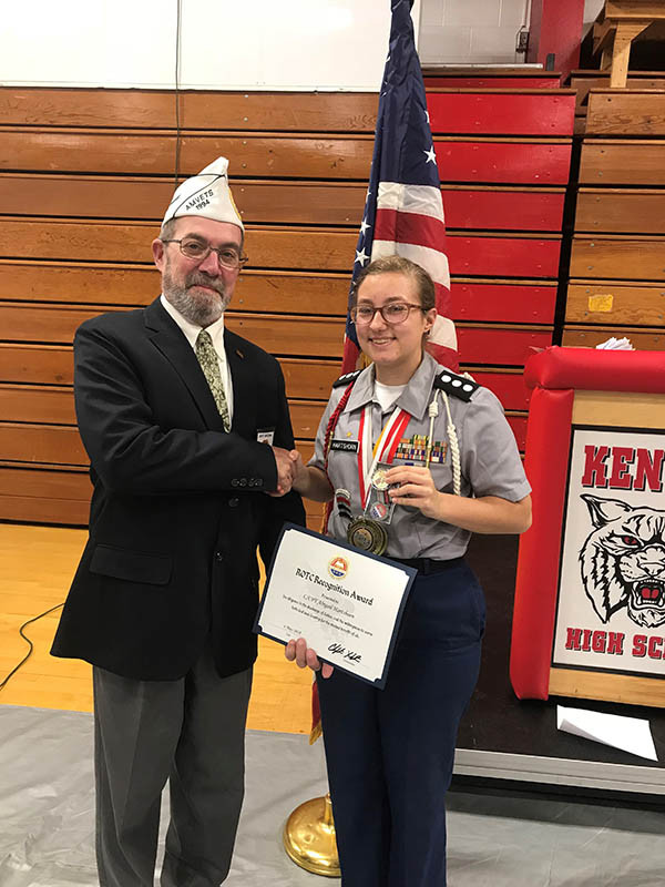 Jeff Brown, 9th district commander for AMVETS Department of Ohio, gives the AMVETS award to cadet Abigail Hartshorn at Kenton High School on May 4, 2018.