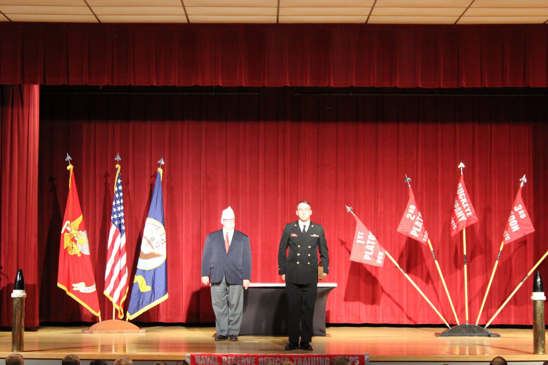 Bill Roese, AMVETS Department of Ohio 12th District Commander gets ready to give the AMVETS Award to Midshipman Robert Milburn (Navy) who is majoring in Construction Systems Management at The Ohio State University.