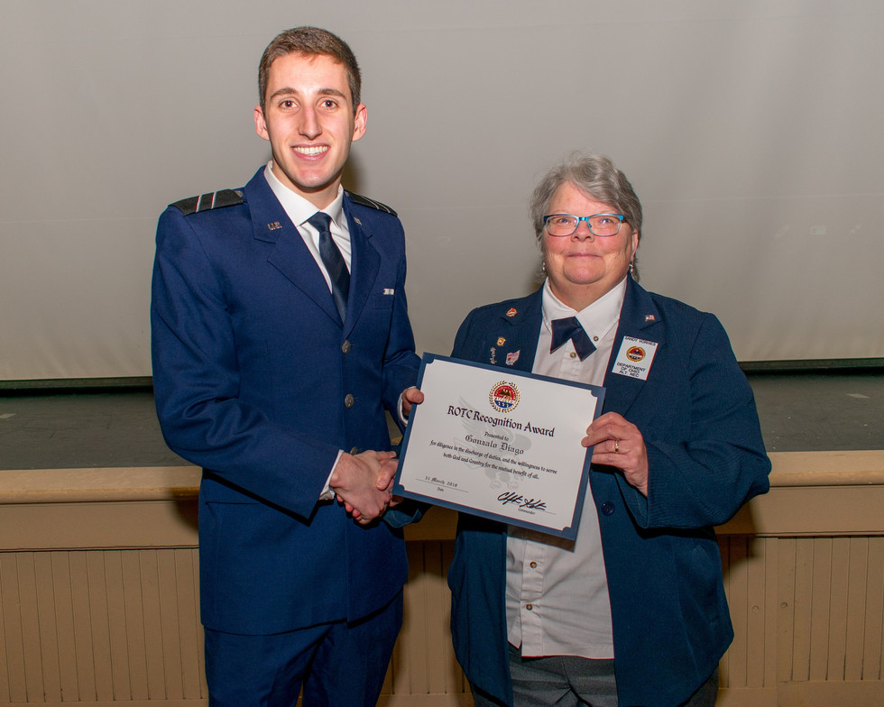 Sandy Vorhies, the AMVETS Department of Ohio Alt. NEC, presents the AMVETS ROTC award to Gonzalo Diago, at The Ohio State University at the detachment's annual awards ceremony on March 31, 2018. Diago is majoring in computer engineering.