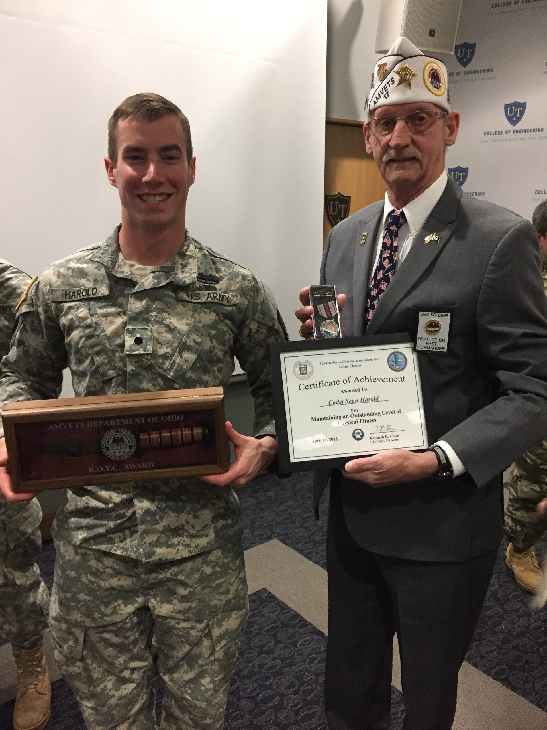 Past Department Commander, Eric Scherer  gives the AMVETS Award to the top University of Toledo Cadet.