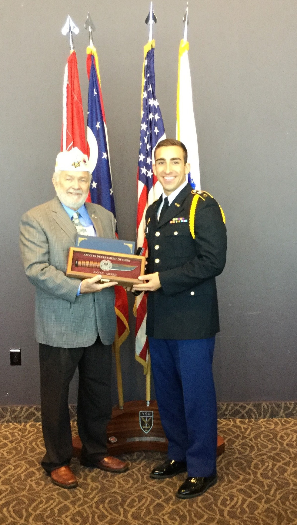 "AMVETS Past National Commander John P. ""JP""Brown III presents the AMVETS Department of Ohio Award to Cadet MS-3 Zachery Marr at Youngstown State University. Marr is a Exercise Science major."