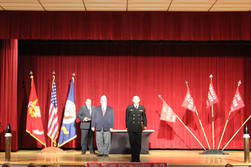 Bill Roese, AMVETS Department of Ohio 12th District Commander gets ready to give the AMVETS Award to Midshipman Gabriel Smith (Marine) who is majoring in Industrial and Systems Engineering at The Ohio State University.