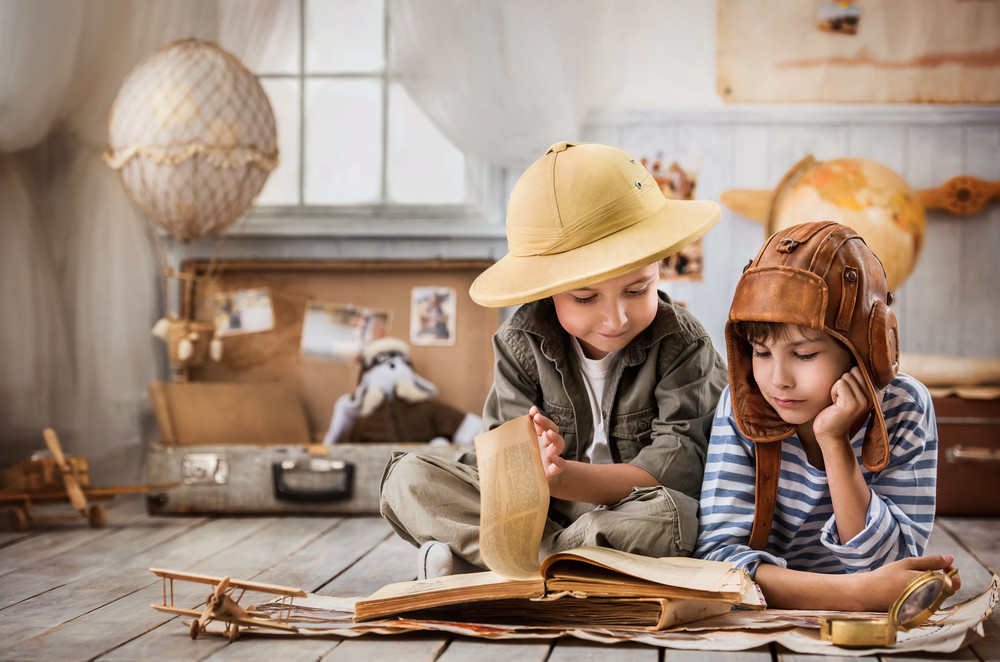 Young kids reading an adventurous book