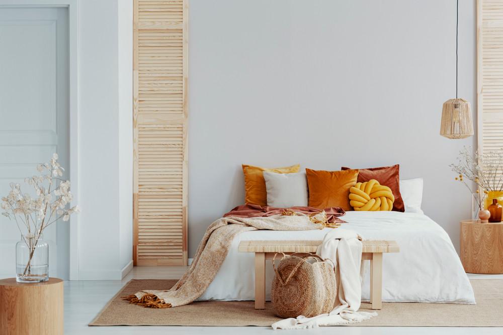 Bedroom with earthy tones and Scandinavian interior