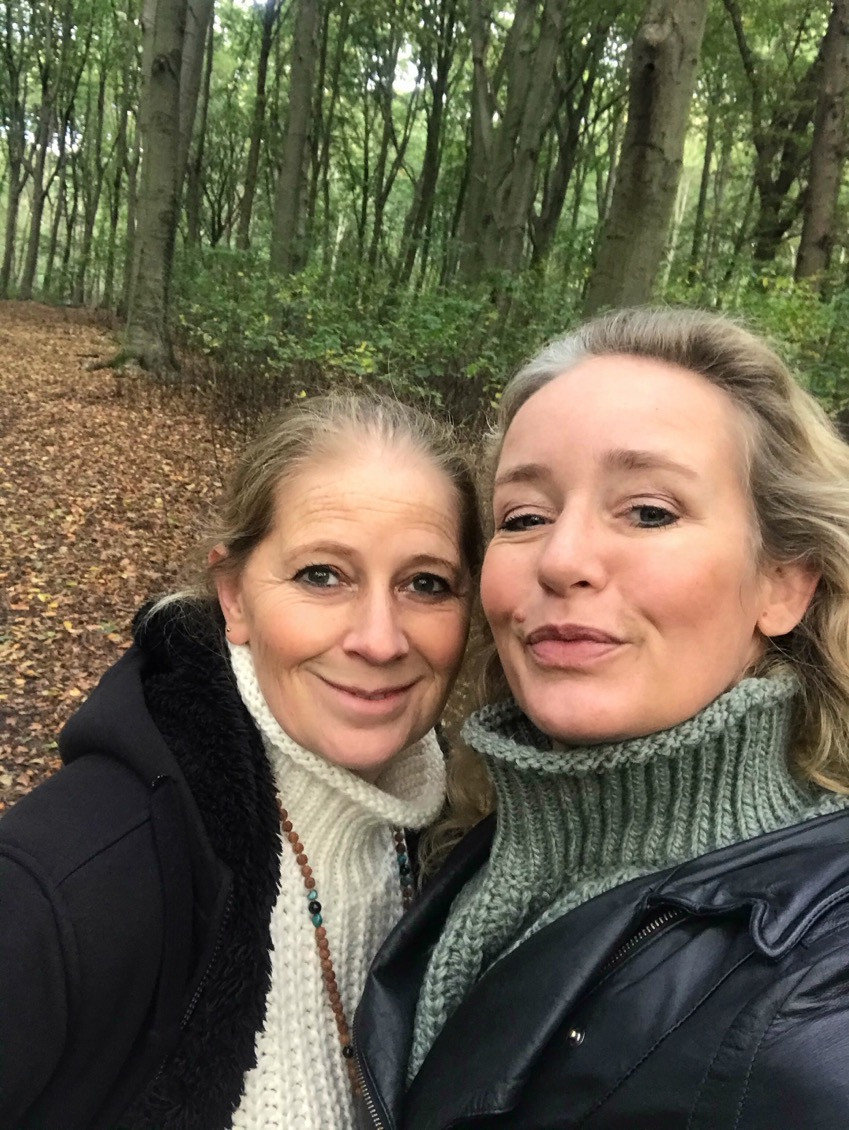 Two-young-women-in-forest-taking-selfie