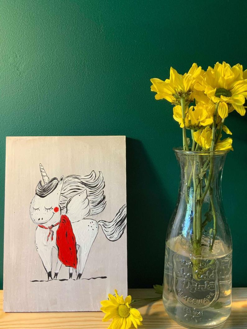 Artwork-on-wood-drawing-of-superhero-unicorn-handmade