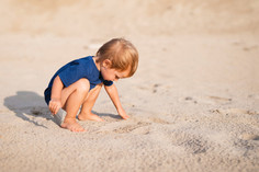 front-view-little-boy-at-beach-playing.j