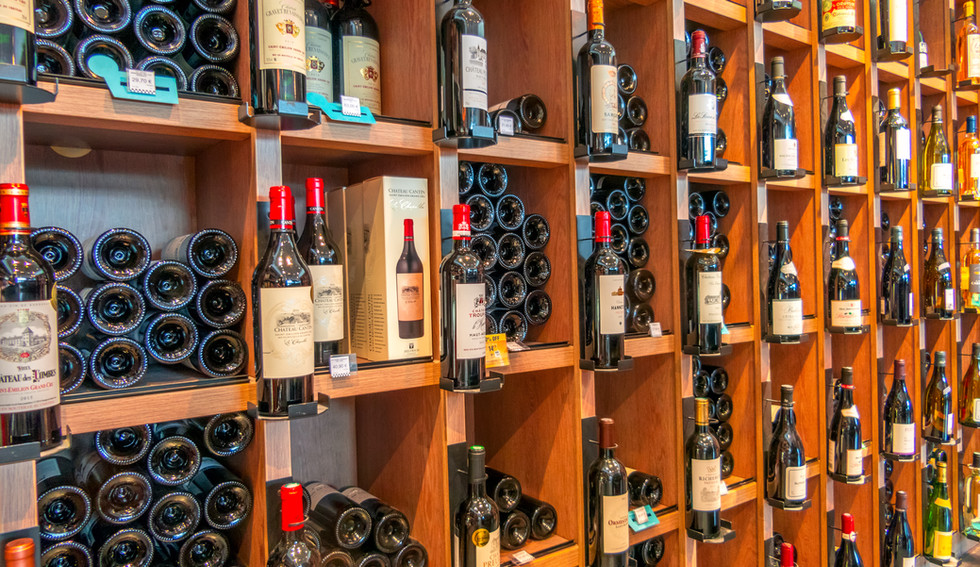 france-paris-a-small-liquor-store-many-white-and-red-wines-on-the-shelves.jpg