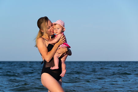 caucasian-female-baby-first-time-at-sea-
