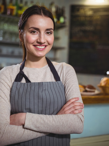 portrait-of-smiling-waitress-standing-at