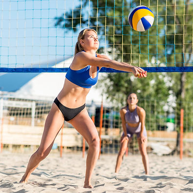 female-volleyball-players-playing-on-the
