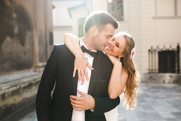 cheerful-newlyweds-in-sunlight-on-street