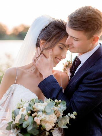 portrait-of-tender-wedding-couple-near-w