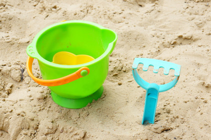 plastic-toy-bucket-and-a-blue-sand-rake-