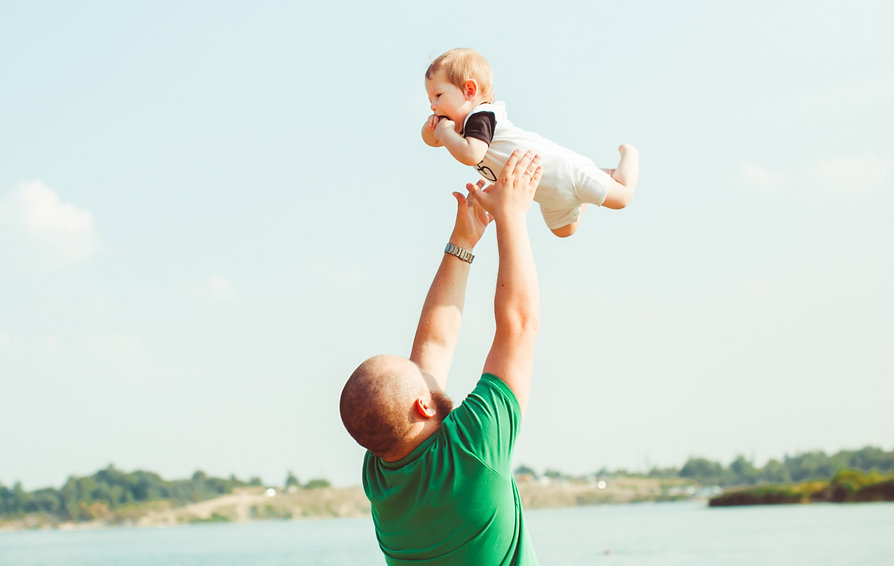 man-in-green-shirt-throws-his-child-up.j