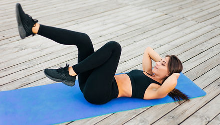 slim-fit-woman-doing-exercises-for-abdom