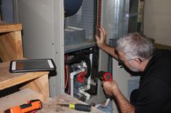 Tom Harp Inspecting HVAC Equipment