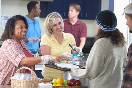 women-volunteering-at-soup-kitchen-Think