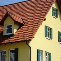 Einfamilienhaus Fassade streichen.