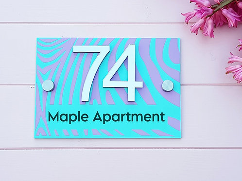 copy of door number sign in acrylic, 3d mirrored numbers, tropical swiss cheese