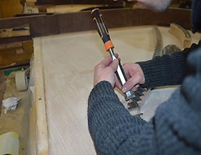 A grand piano being restored by our expert piano technicians