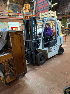 Lifting A Piano In A Studio In Sheffield Using A Forklift 1