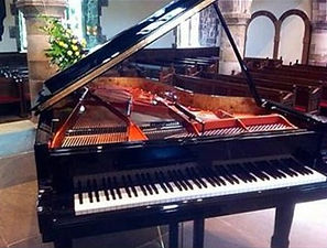 One of our top-quality hire pianos ready for an event