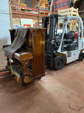 Lifting A Piano In A Studio In Sheffield Using A Forklift 2