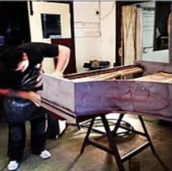 A piano being French Polished by one of our professional piano technicians