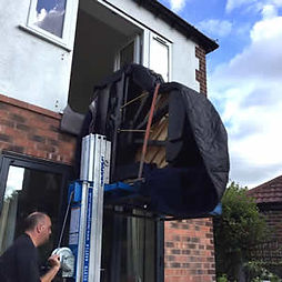 A piano removal being carried out by our expert transport team