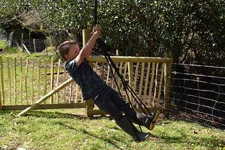 Herbert on Outdoor Classroom rope swing.jpg