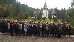 Group of tourists in front of Peles Castle, Romania