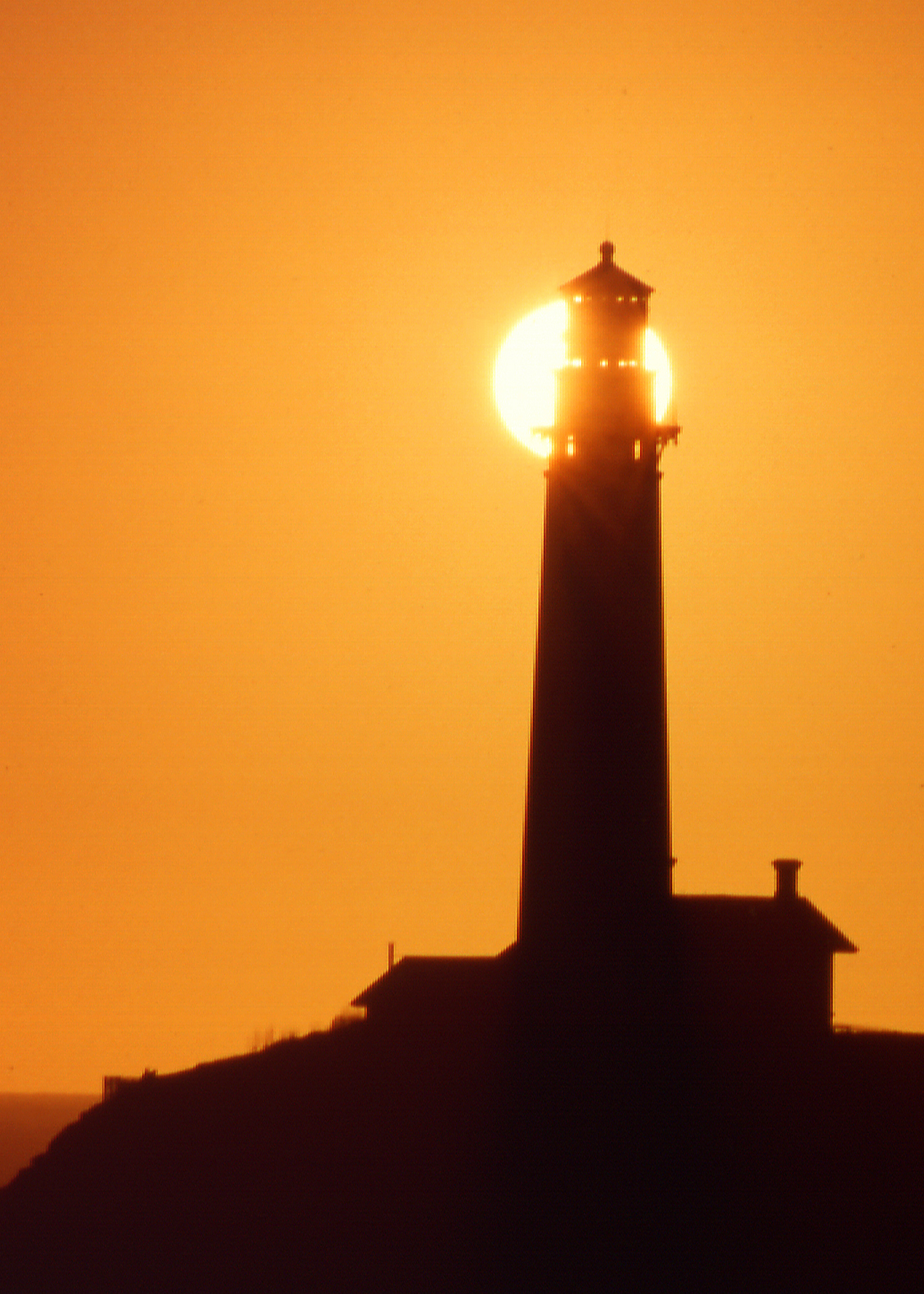 Lighthouse Revealing Sun