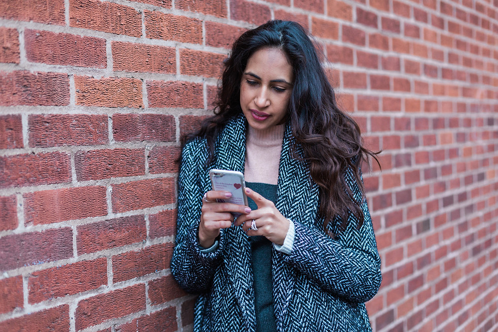 Renu texting during personal branding shoot in Leicester