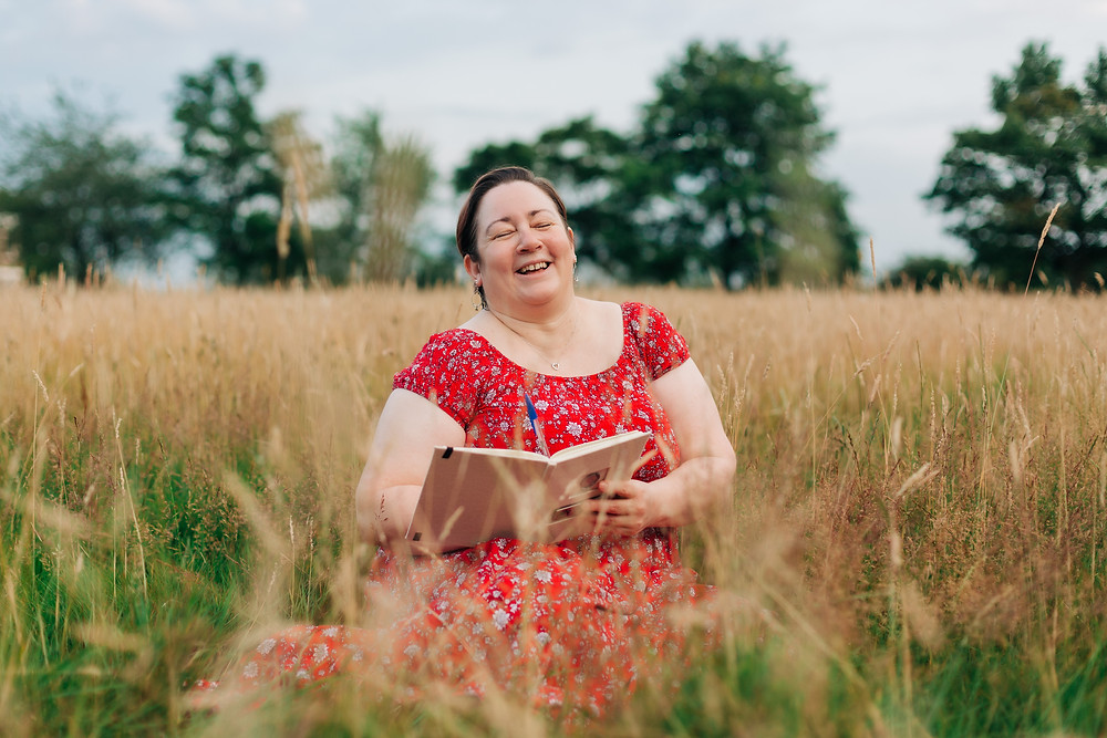 Laughing lady in a red dress during her personal branding photoshoot by Deepa Rodrigues Photography