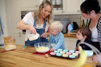 Mum pouring milk into a bowl