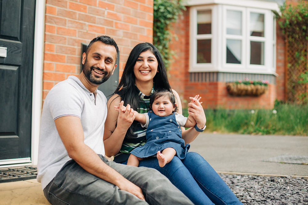 Family of 3 sitting on their doorstep in Leicester