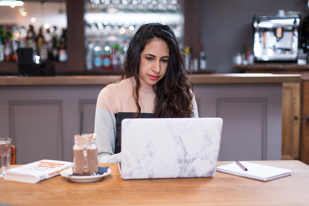 Girl working on laptop in Leicester during a personal branding shoot
