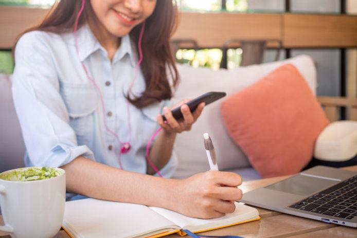 asian-woman-sitting-holding-phone-listen