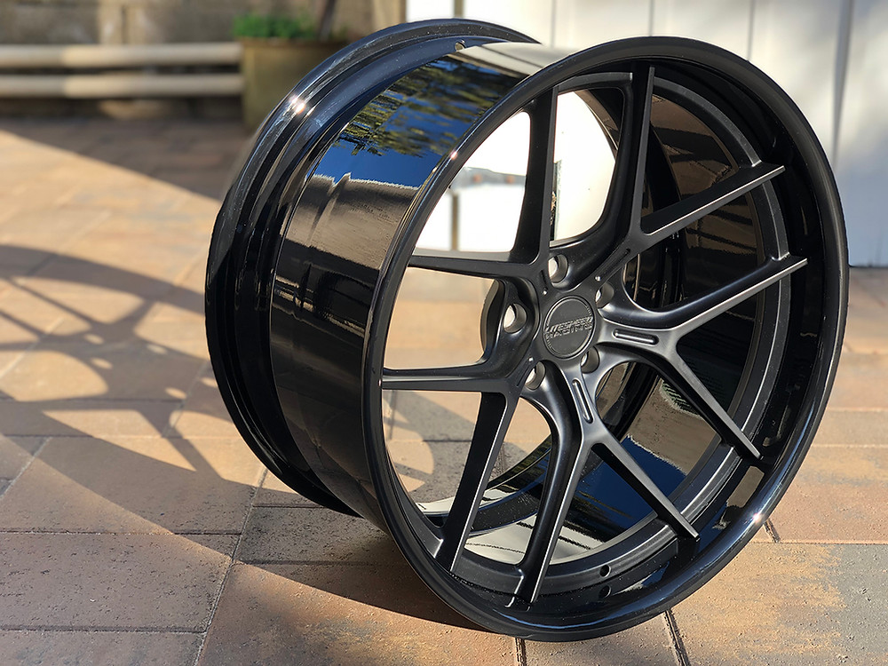 forged magnesium three piece wheel in satin black with gloss black lip