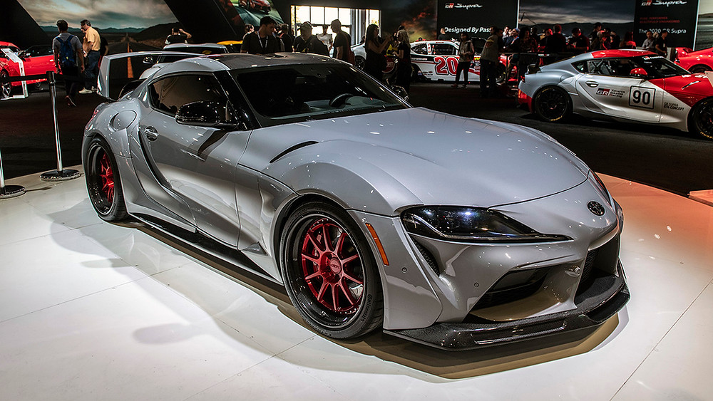 Grey Toyota GR Supra widebody with red carbon fiber wheels