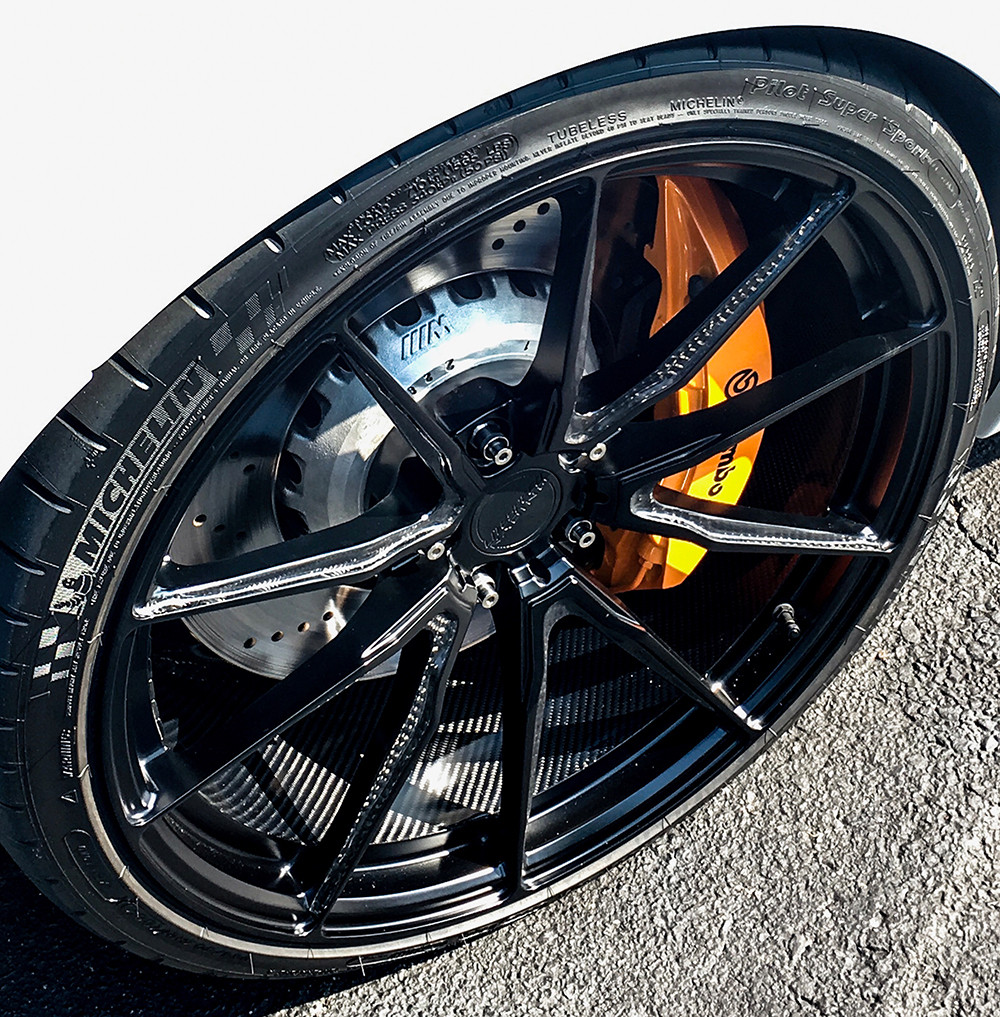 carbon fiber wheels on white bmw m5 by Litespeed Racing