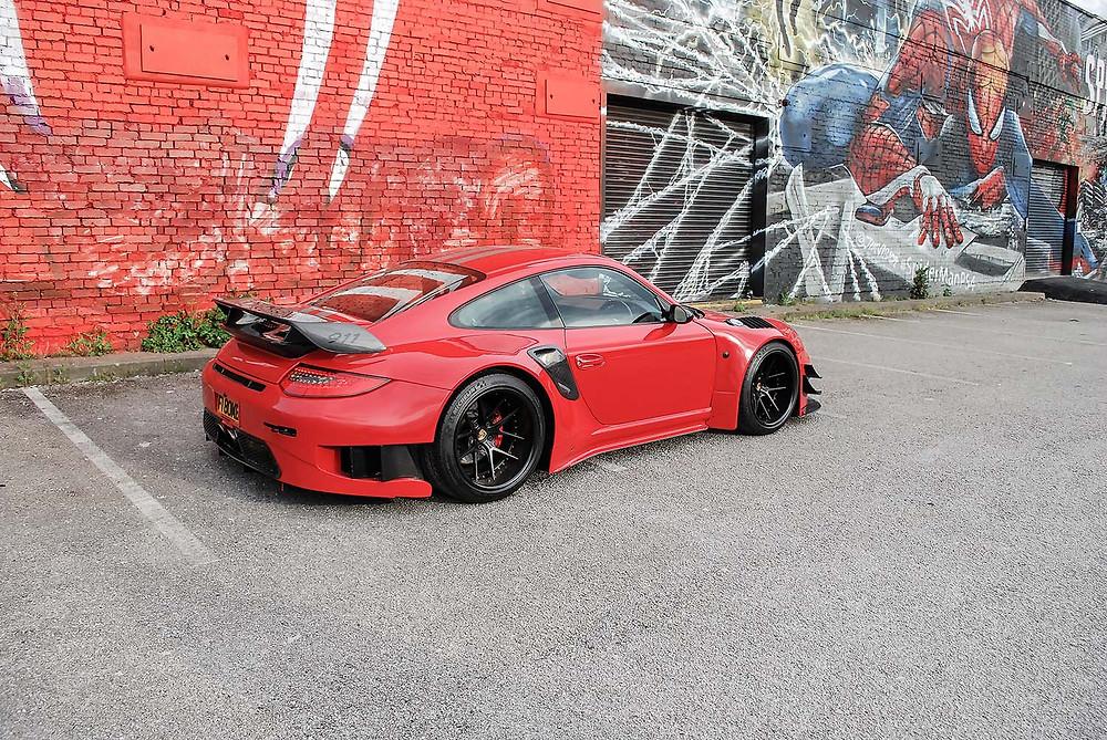 red widebody porsche 911 turbo