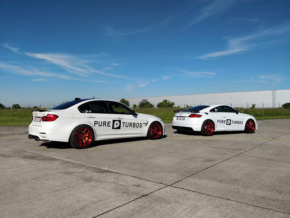 white BMW F80 M3 with red wheels and white audi TTRS with red wheels
