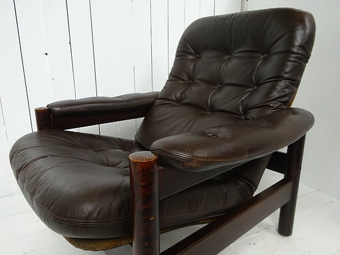 danish leather armchair, brown leather danish armchair, 1970's fashion, rosewood frame, 1970's style chairs, worn leather