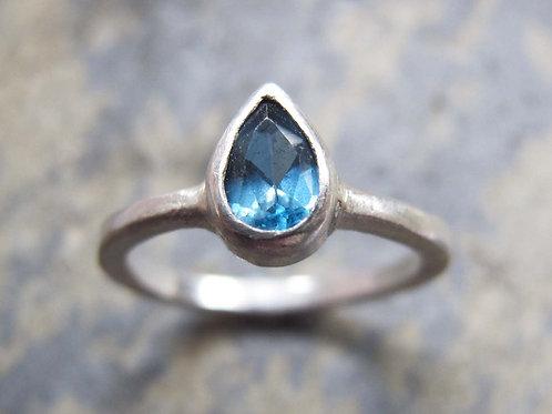 pear shaped London blue topaz ring
